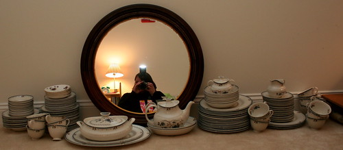 A girl, her mirror and lots of china...