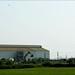 factory beside a field