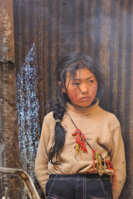 Tibetan girl, Litang, Sichuan, China.