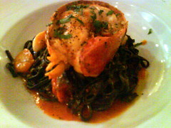 Squid ink taglierini with lobster in light tomato emulsion