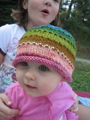 Kailey in a colorful hat for baby