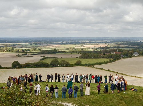 Pagan circle at Autumn Equinox, beneath The Long Man, on Windover Hill, Sussex Downs by chrisjohnbeckett
