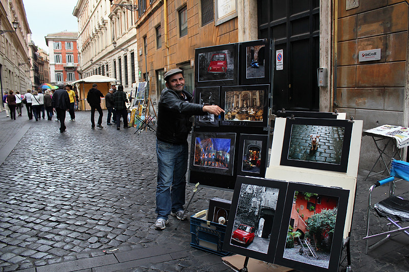 A street artist showing off his works