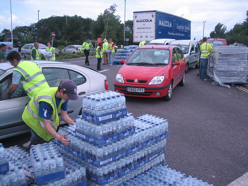 Council staff give out bottled water at B&Q car park, Cheltenham