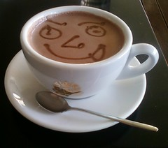hot cocoa with face drawn on foam