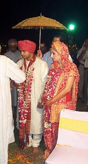 the bride and the groom enter the wedding mandap