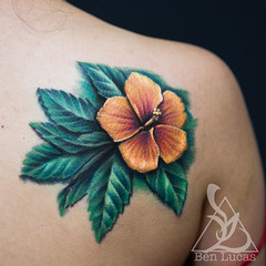 Justines-yellow-and-red-Hibiscus-with-Green-foilage-3D-cover-up-Tattoo-by-Ben-Lucas-at-Eye-of-Jade-Tattoo-in-Chico-CA-USA