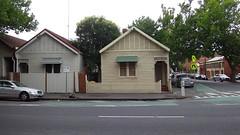 Деревянные домики. В моем детстве примерно такие на базах отдыха были.