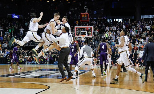 The Irish men's basketball squad was in a celebratory mood Sunday after freshman Rex Pflueger's tip-in with 1.5 seconds left earned Notre Dame a second straight Sweet 16 berth. Photo credit: Emmet Farnan | The Observer