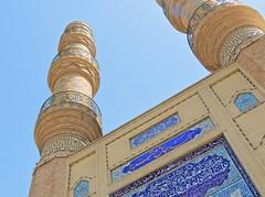Tall minarets of old brick mosque of Tabriz in Iran