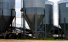 Stewart has his four-wheeler parked in between the silos.