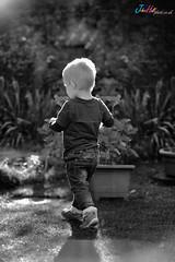 Boy walking away (B&W)
