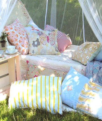 Cushions in the garden by saabye p