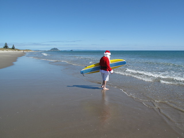 Santa shops at Palm Beach Plaza Papamoa whilst catching a wave