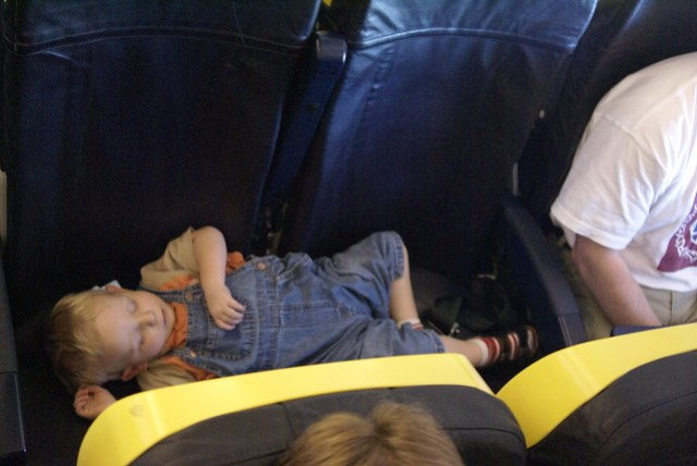 Léon asleep on the plane