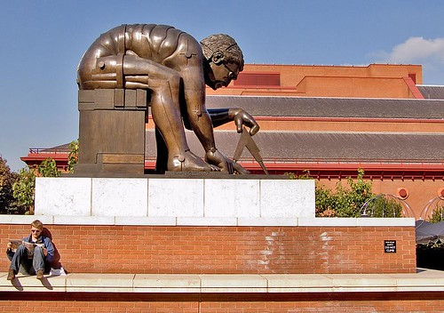 """Sun"" newspaper reading under Isaac Newton, British Library Piazza"