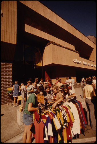 Teenagers Look at Sale Merchandise During a Crazy Days Promotion by Merchants on Minnesota Street in Downtown New Ulm Minnesota...