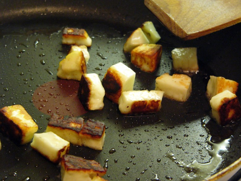 Halloumi cubes being fried