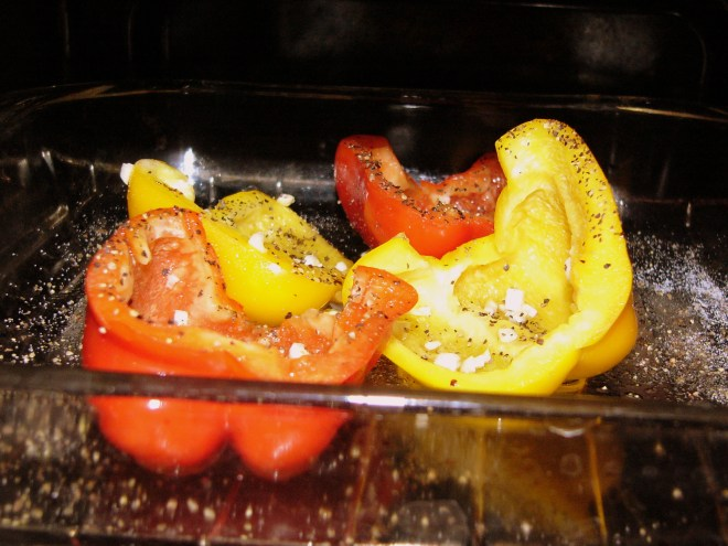 Peppers seasoned and in the oven