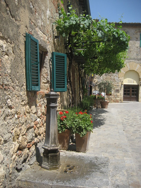 The little fountain with drinking water in the main square of Monteriggioni