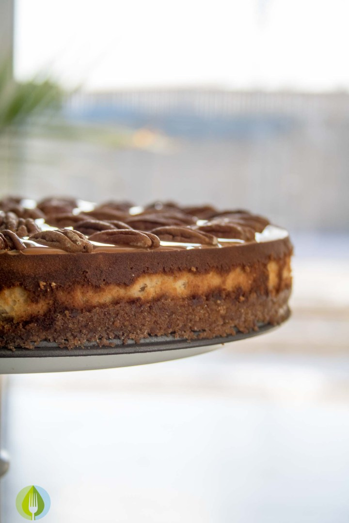 Spiced Whisky Pecan Pie Cheesecake - whole cake on a cake stand. Pecans Pie Cheesecake