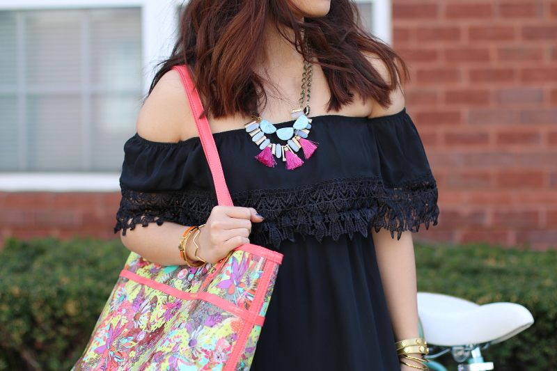 black-off-shoulder-dress-tassel-necklace-sakroots-tote-6
