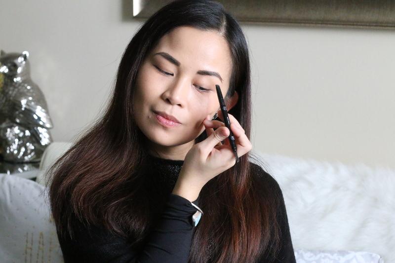 applying eyebrow pencil
