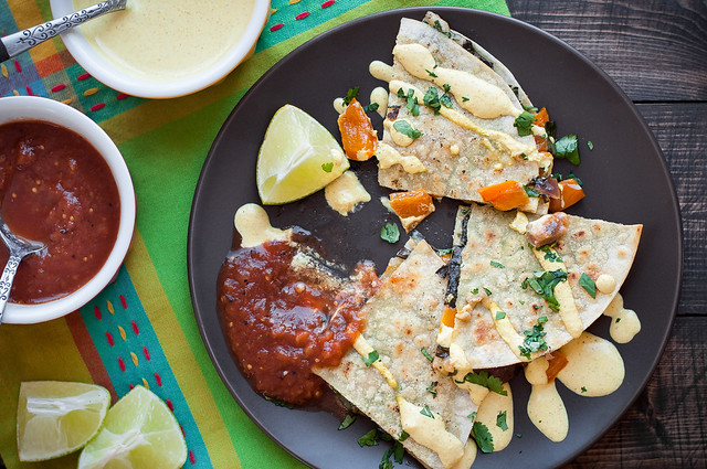 If you're tired of the same old kale quesadillas routine try these Indian spiced ones with a side of curry sour cream sauce