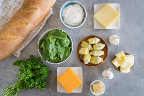 fresh vegetables, lots of garlic, and three types of cheese