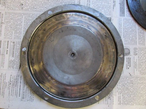 Pressure Plate Shows Grooves and Discoloration, Compression Ring is Similar