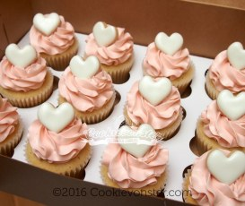 Mini cookie-heart topped cupcakes