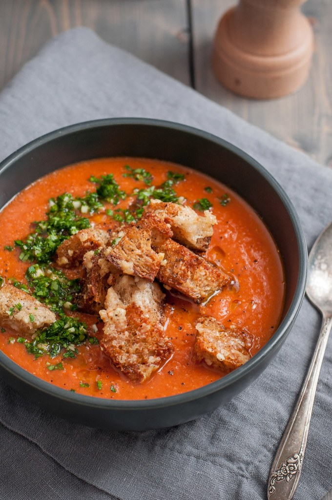 Gluten free and dairy free creamy tomato soup thickened with white beans and topped with the most delicious homemade croutons ever.
