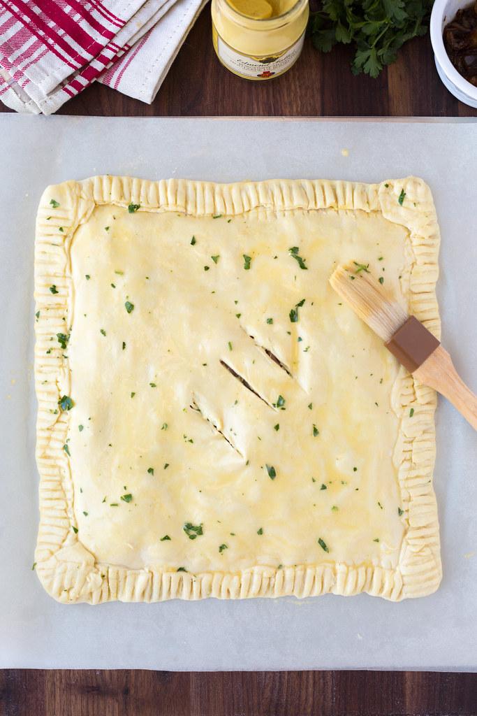 assembled ham and swiss slab pie on baking sheet