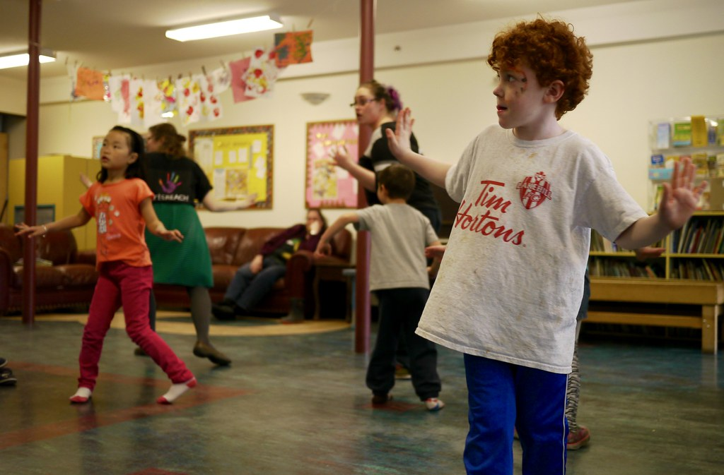 Kids learn fun dance moves during a Hip Hop workshop at the artsREACH 10th anniversary celebration.