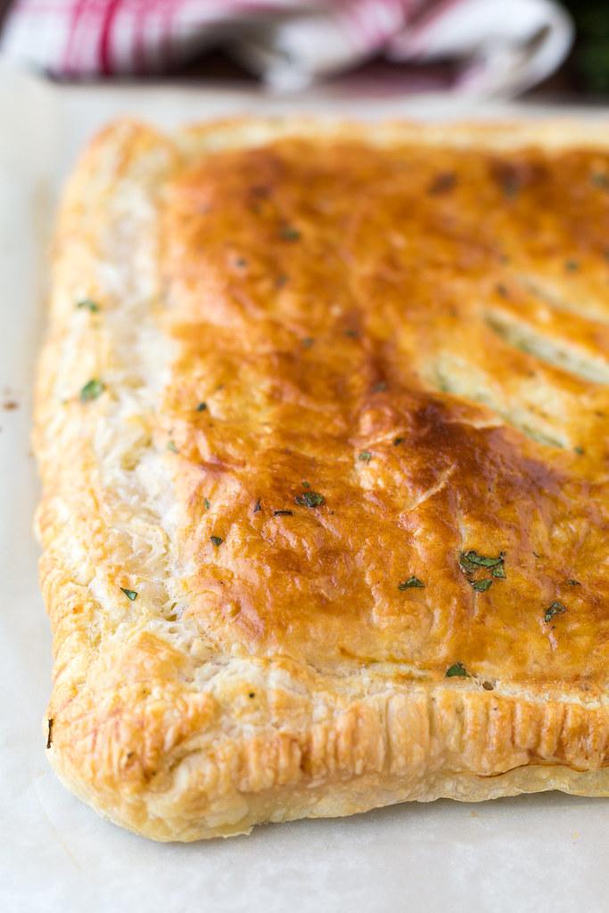 closeup of baked ham and swiss slab pie