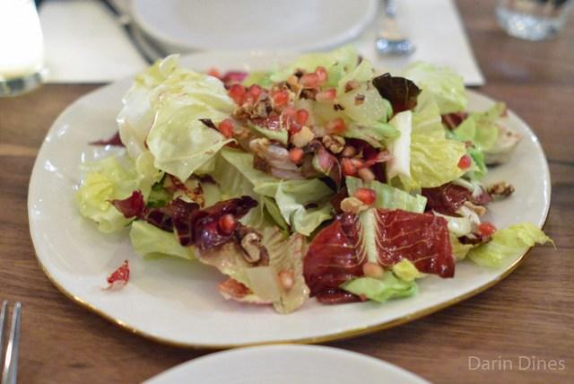 Simple green salad, fuyu persimmon, radish, herbs