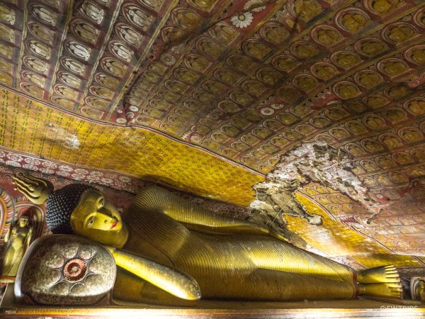 Sleeping Buddha at Golden Temple of Dambulla - Dambulla, Sri Lanka.jpg