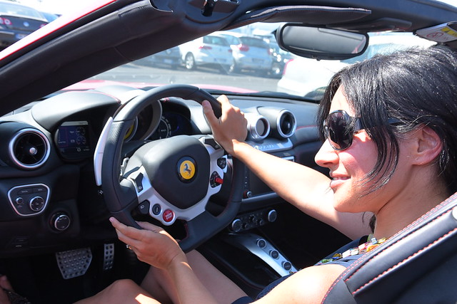 the ferrari experience in Florence: me in the car, looking uncomfortable in front of the camera