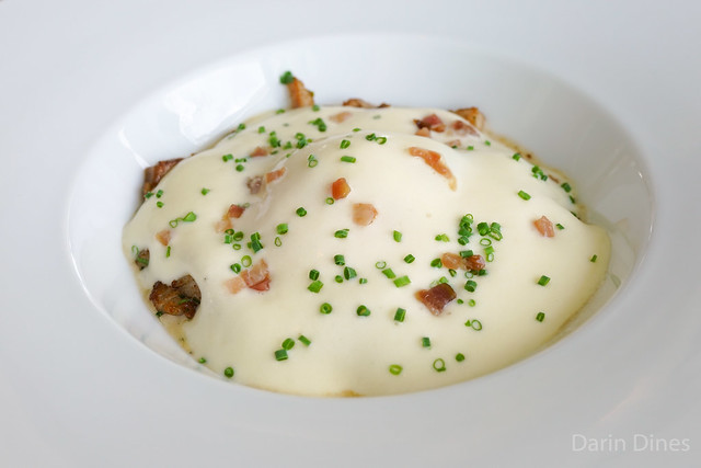 Organic Egg slow cooked, sautéed iberico pork belly, braised leek, potato espuma, truffle butter