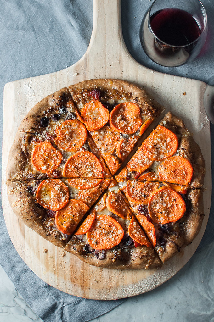 Sweet potato pizza with the savory flavors of kalamata olives, fresh herb pesto, nutty Gruyere, and salty parmesan for the ultimate Mediterranean pizza.