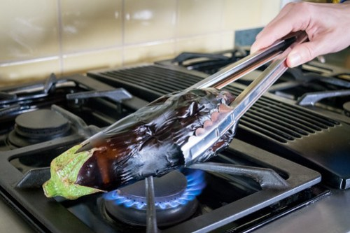 roasting eggplant over an open flame