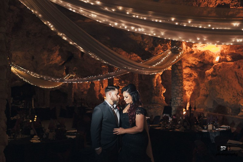Elegant goth wedding in a cave as seen on @offbeatbride