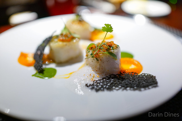 Le Cabillaud pan seared cod fillet with pimento olive oil, smooth carrot puree and coriander sauce