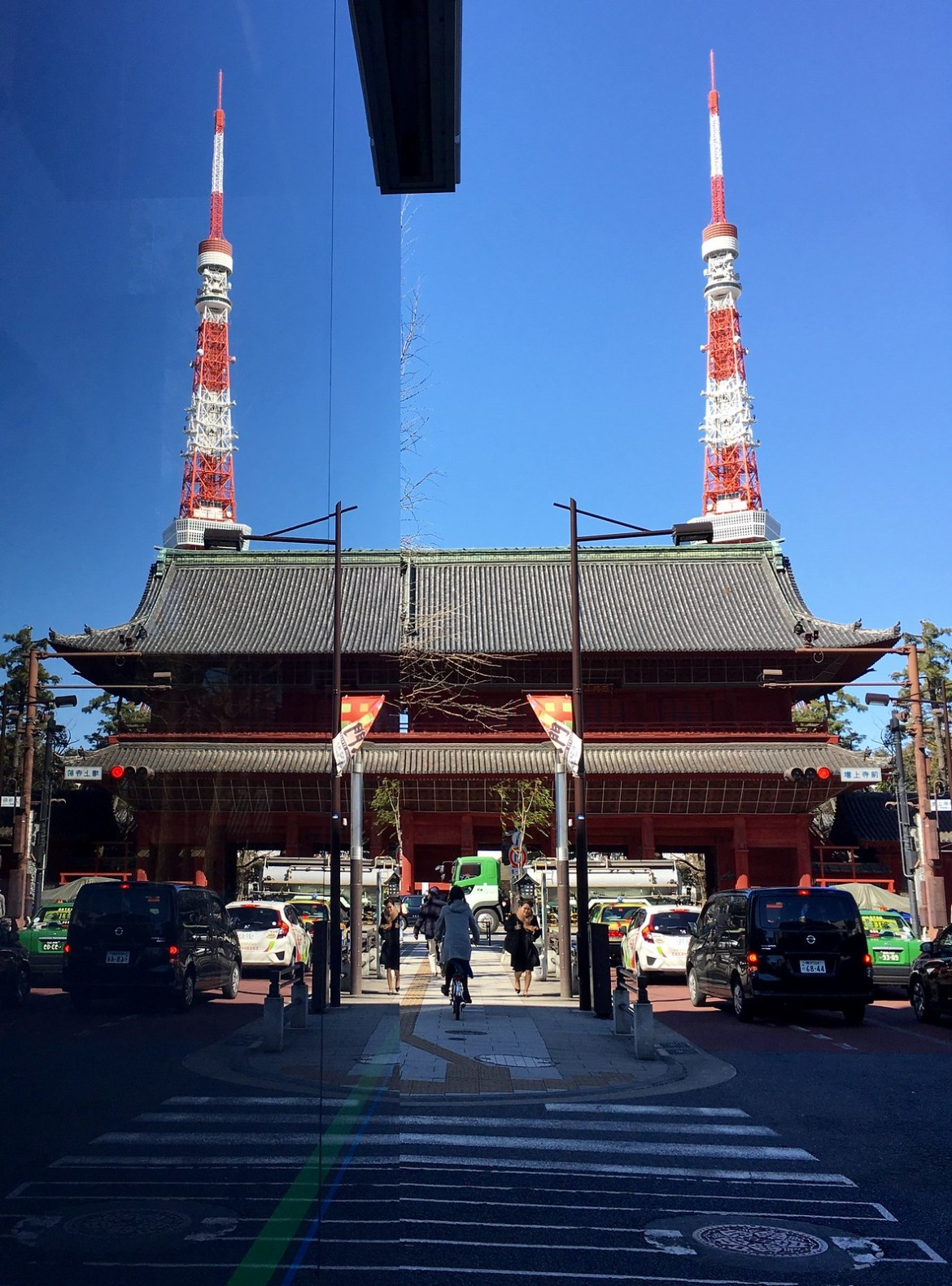 Reflection of Tokyo Tower in the Family Mart convenience store Zojoji Temple