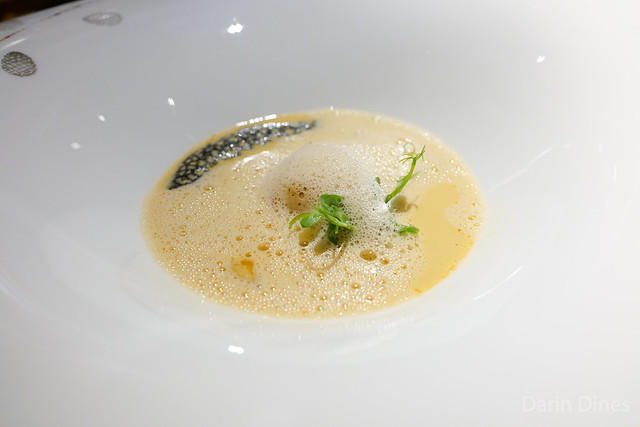 La Langoustine fine scampi bouillon with seasonal vegetables and pine nuts