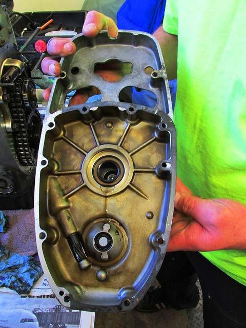 Inner Timing Cover Removed Showing the Back Side with Front Crankshaft Seal (Top) and Camshaft Seal (Bottom)