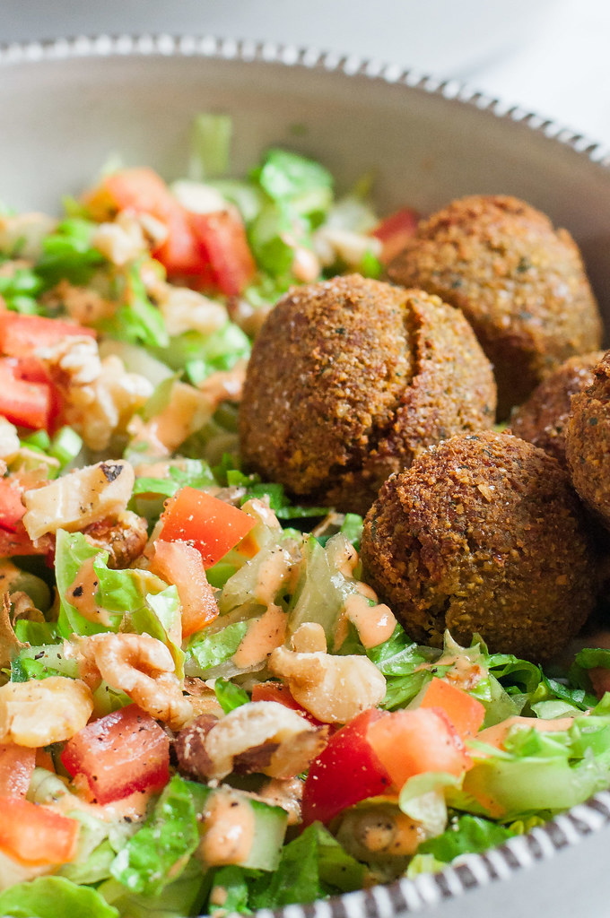Falafel sandwiches are amazingly delicious, but if you want to skip the bread, falafel SALAD is where it's at! Secretly healthy, even covered with a creamy vegan roasted pepper dressing.