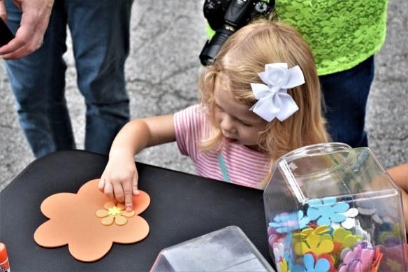 Mila decorates her flower