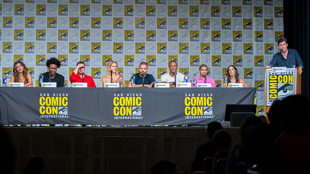 Juliana Harkavy, Echo Kellum, Colton Haynes, Emily Bett Rickards, Stephen Amell, David Ramsey, Rick Gonzalez and Beth Schwartz with Moderator Ralph Garman