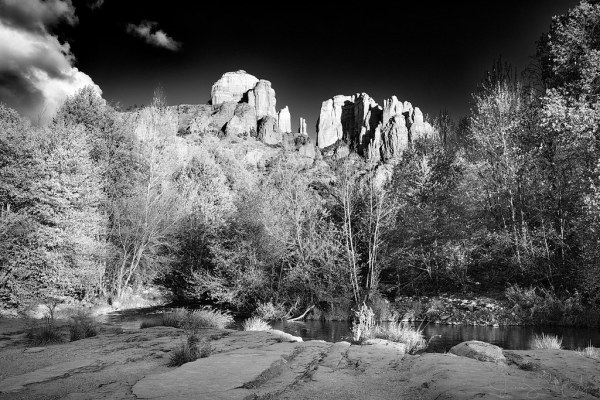 Cathedral Rock, Sedona by Jeanie Sumrall-Ajero. A yellow filter was used to brighten the red rocks along with the spring green leaves and darken the blue sky. The strength of the filter was significantly increased during conversion to B&W.